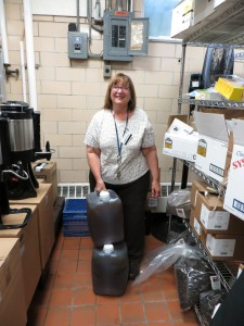 Nancy German, Dascomb Dining Hall manager at Oberlin College, bottling up WVO