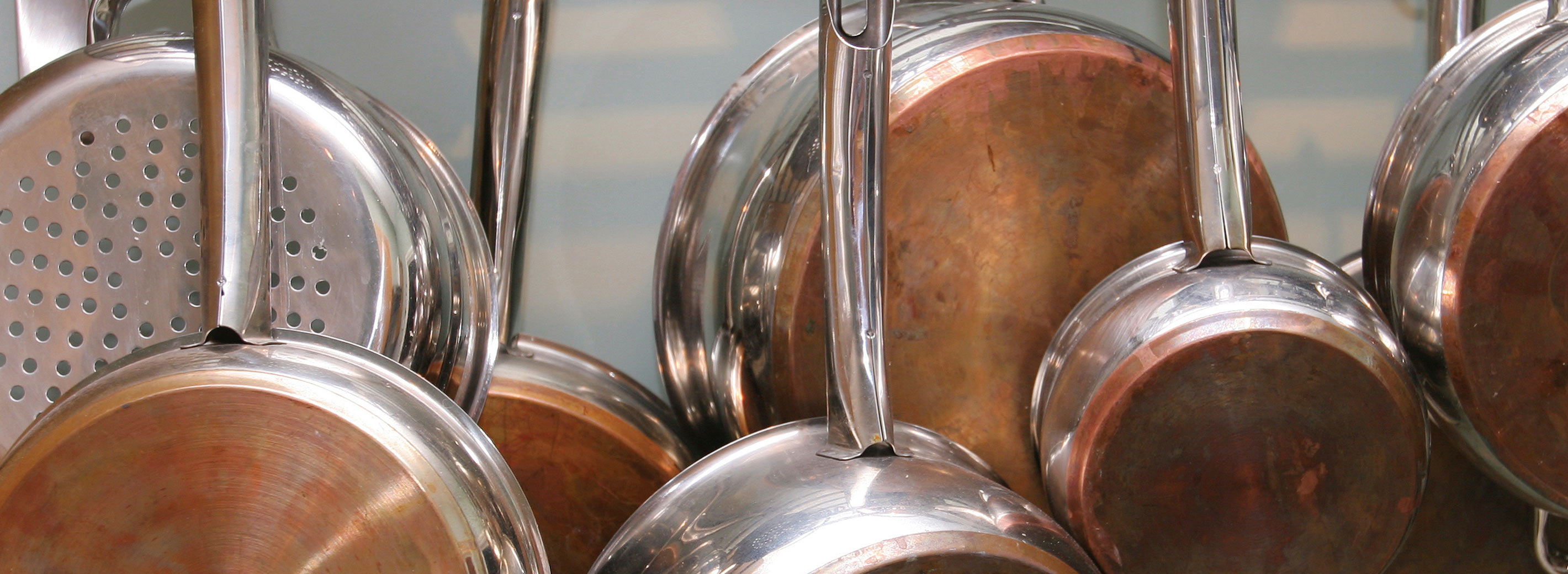 Copper pots and pans hanging