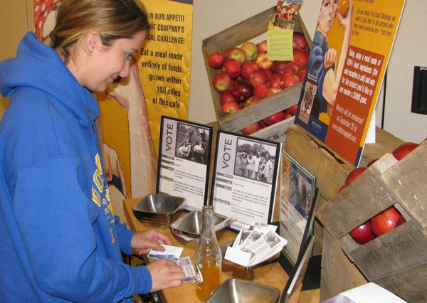 A Goucher College student votes on Eat Local Challenge Day.