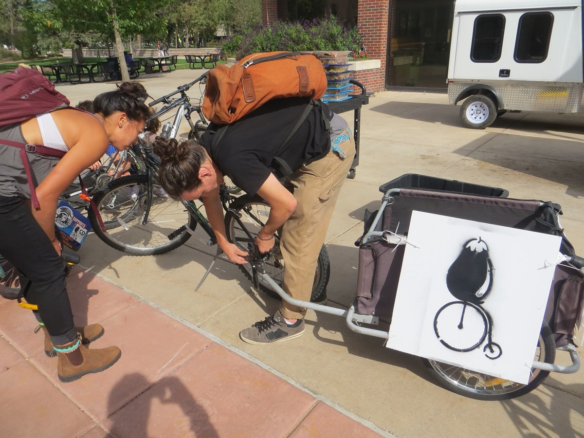 Colorado College students Lonnie and Shane hitch up the trailer to deliver recovered food from Colorado College's Rastall Café to Marion House Soup Kitchen.