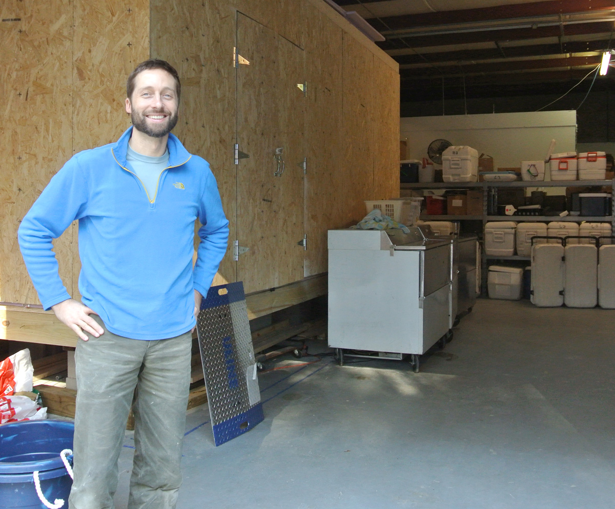 Ryan Speckman, owner of Locals Seafood, in front of the walk-in cooler that he designed and built using the $5,000 Fork to Farm grant the company was awarded this past September.