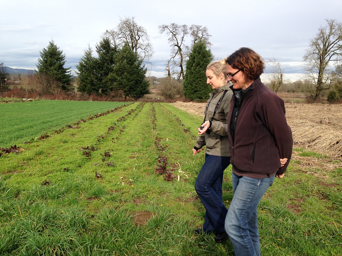 Shari and Claire chat as they walk between the winter cover crop rows