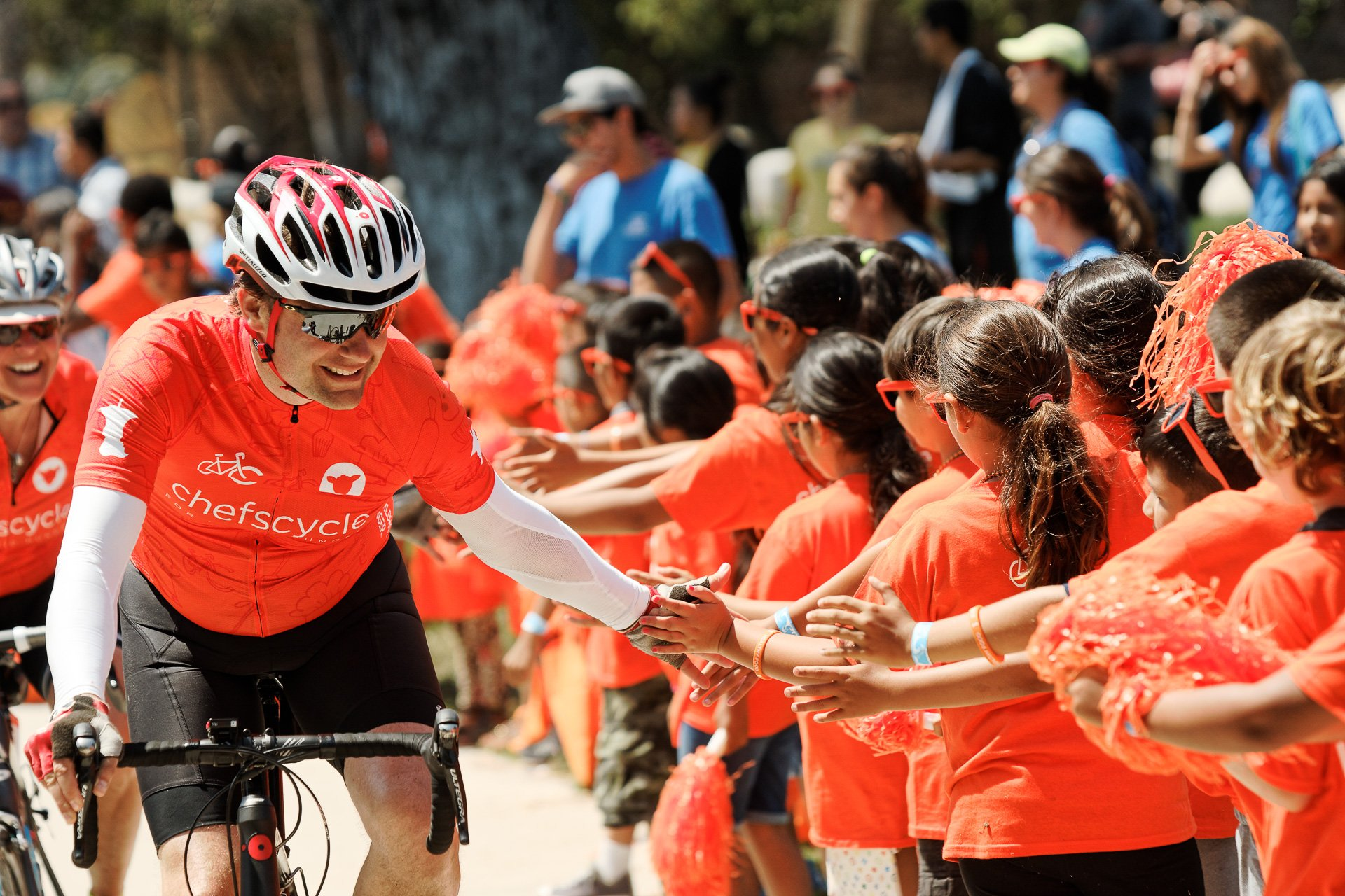 High-fives at the end of the race. (Photo by No Kid Hungry)
