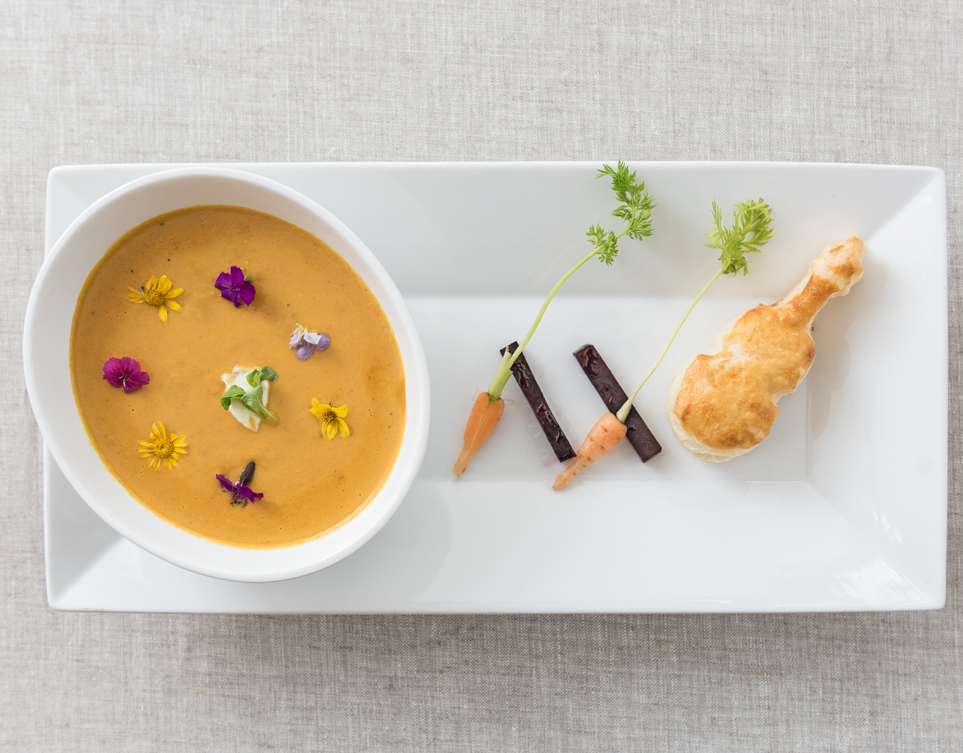 Squash soup with cello-shaped biscuit