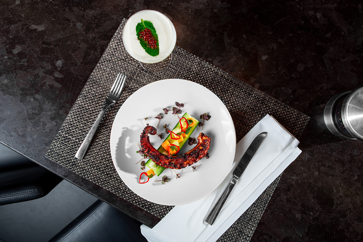 """Provenance's """"Medieval Monsters""""-inspired grilled octopus course evokes imagery of medieval sea monsters overtaking a """"boat"""" of cucumber and seasonal vegetables"""