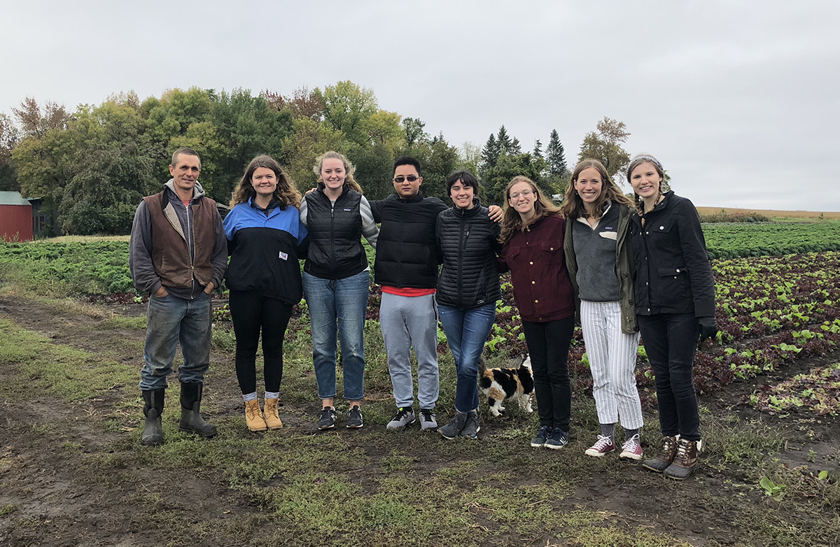 Open Hands farmer Ben Doherty and St. Olaf students