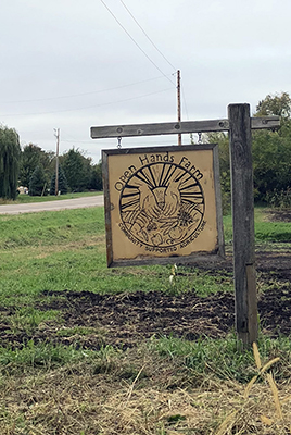 Sign welcoming visitors to Open Hands Farm