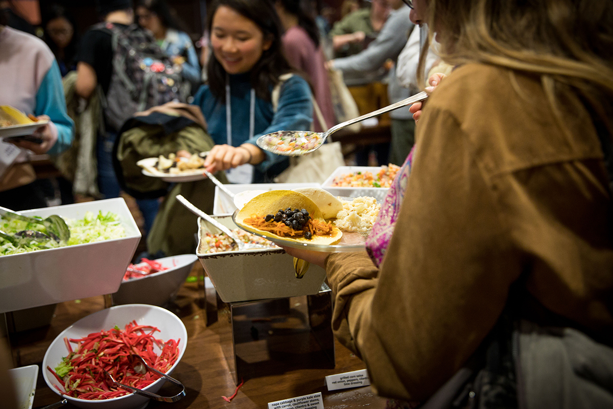 Students wait in the buffet line with their reusable plates