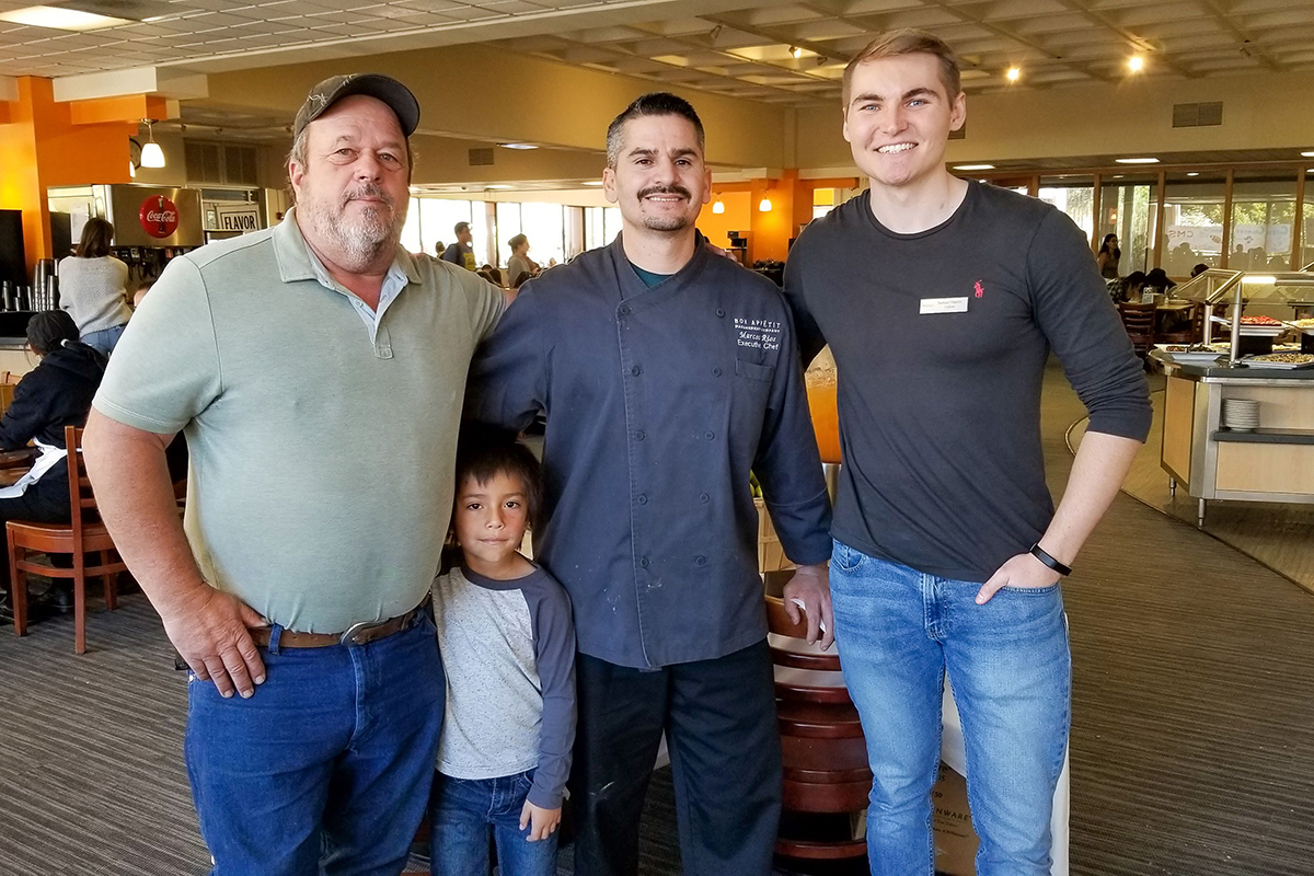 Sage Mountain Farm Owner Phil Noble and his son [check TK], with Executive Chef Marcos Rios and Bon Appétit Fellow Samuel Martin
