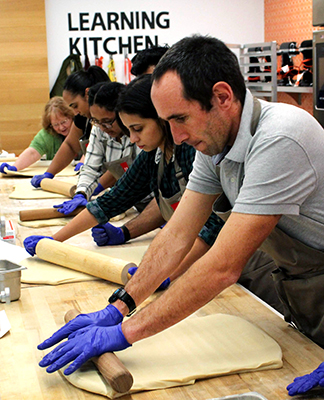 Students rolling dough