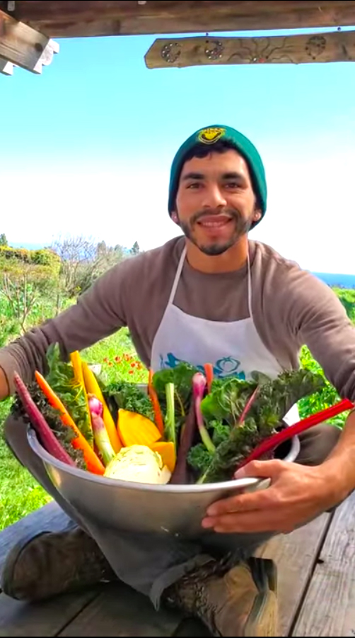 Young man with vegetables