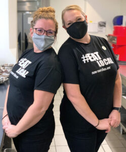 two women in Eat Local t-shirts