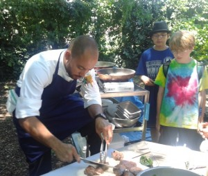 Chef Wil Fernandez-Cruz prepares grass-fed beef tenderloin and kohlrabi salad for a special lunch at camp.