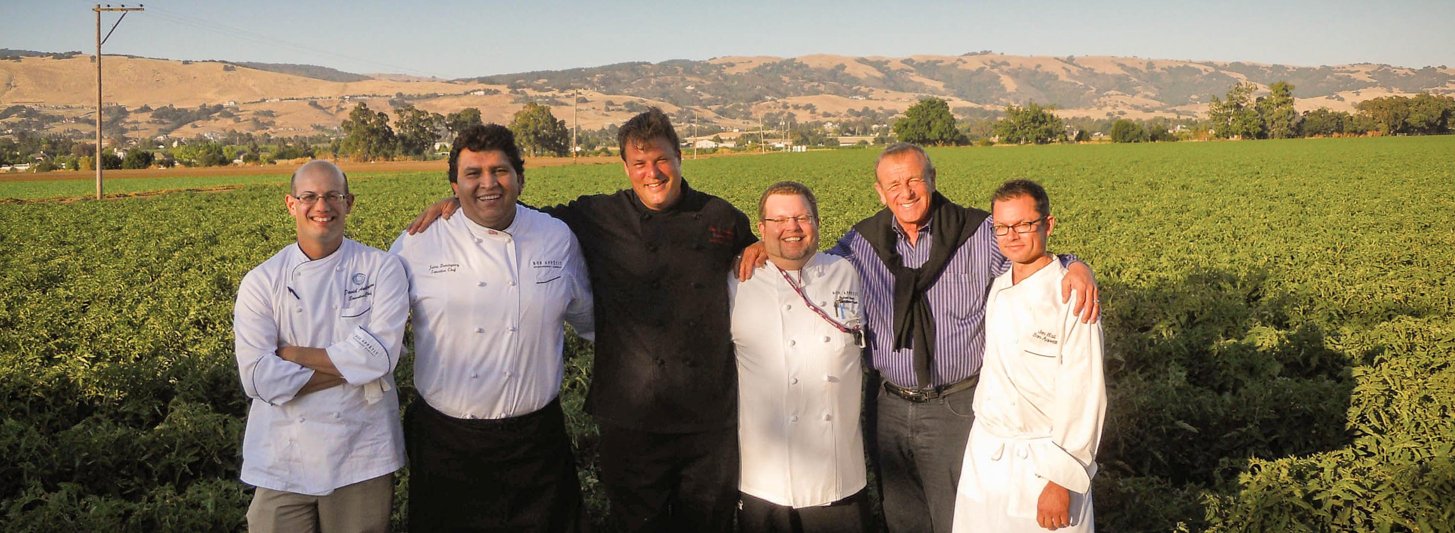 BAMCO chefs and CEO Fedele Bauccio in field