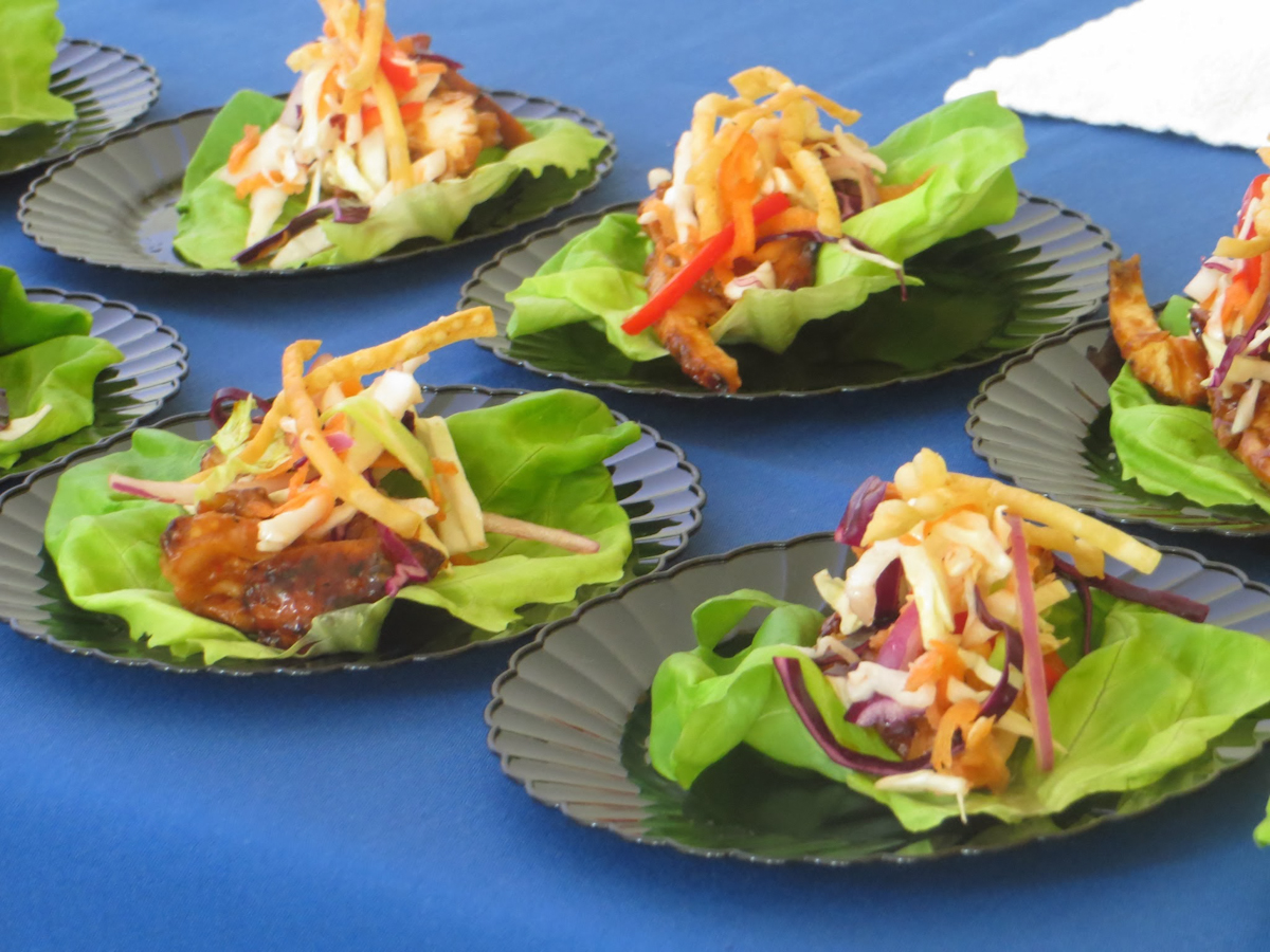 Thai chicken lettuce wraps with plum glaze and fresh vegetable slaw