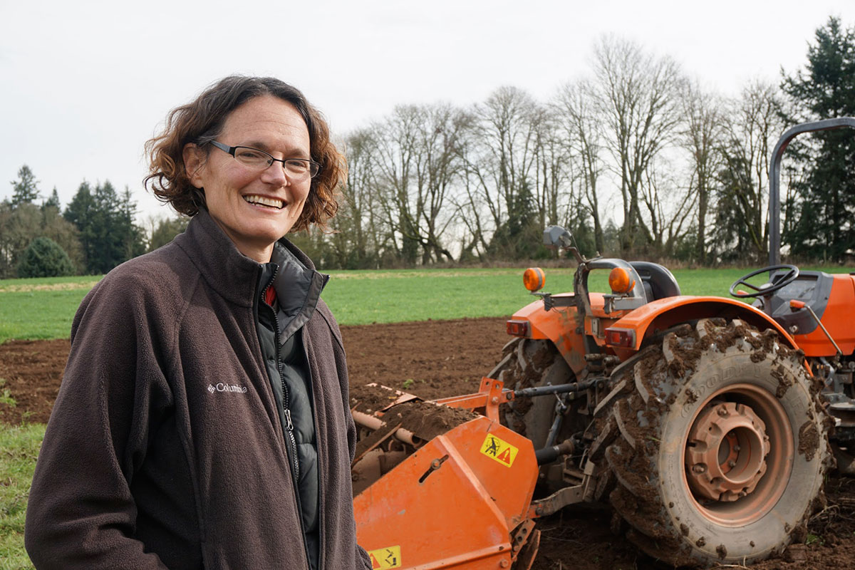 Shari with the farm's spader, which prepares the soil for planting (and preserves its integrity better than a traditional tiller)