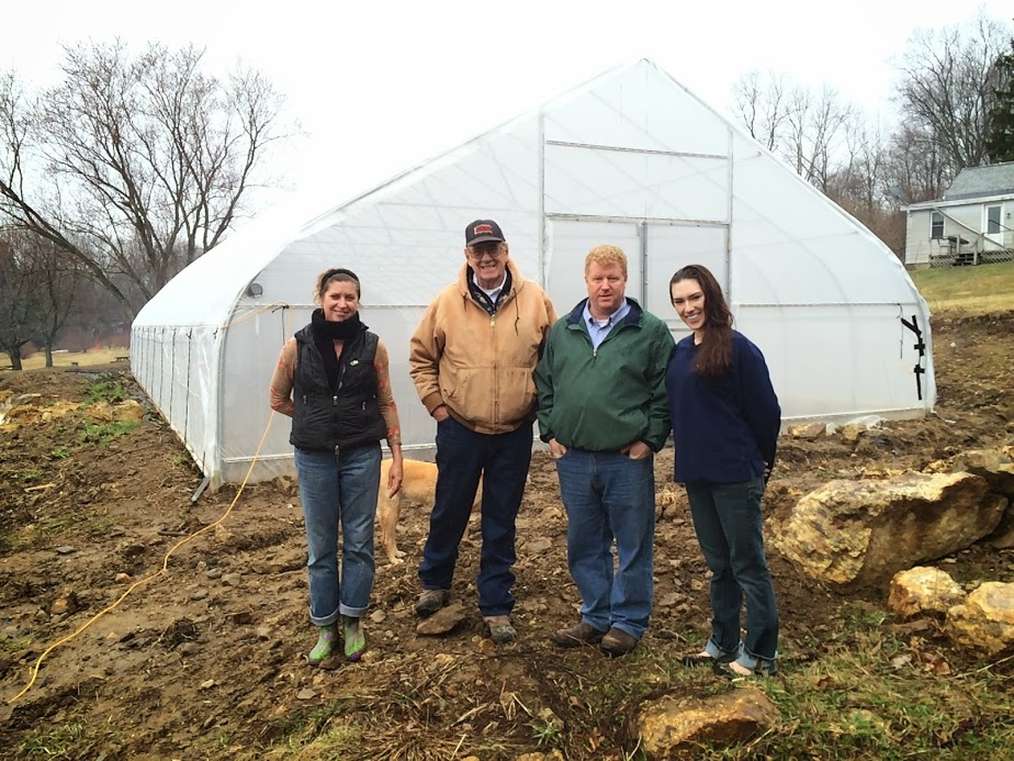 From left to right--Catherine Halliday and Matt Couzens of Horse Listener's Orchard, Don Fitting and Stephanie Keith of Roger Williams University BAMCO team-- standing outside the hoop house made possible by the Fork to Farm grant.
