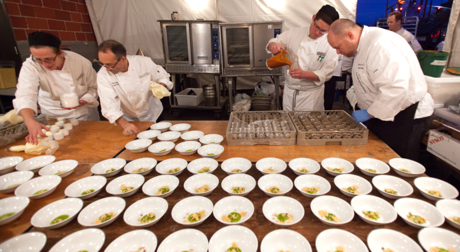The Bon Appétit team preparing the soup, which was served in an innovative way: bowls with parsley pesto awaited guests at the table when they sat down, and then servers poured hot parsnip soup from pitchers into each bowl
