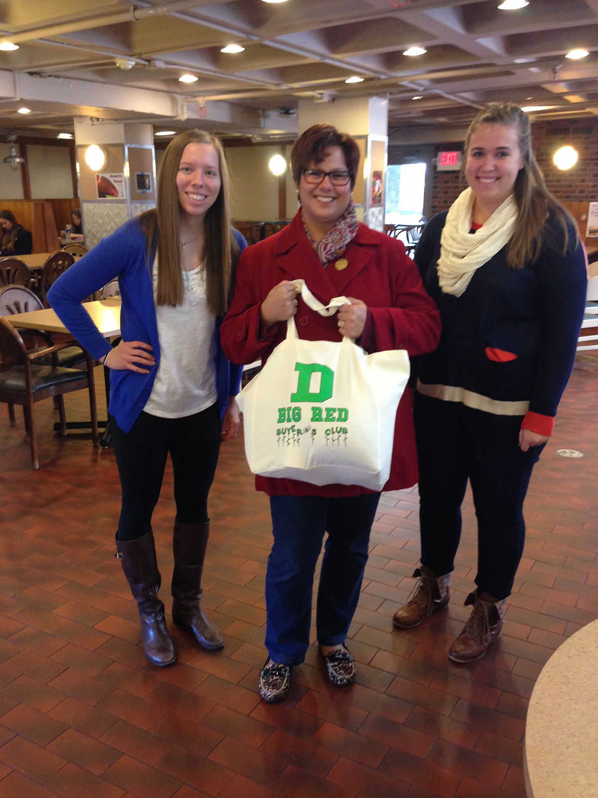 Buyer's club creators Emily Marguerite and Jen Curry with their first customer, Liz Barringer-Smith, sporting her sweatshop-free reusable bag