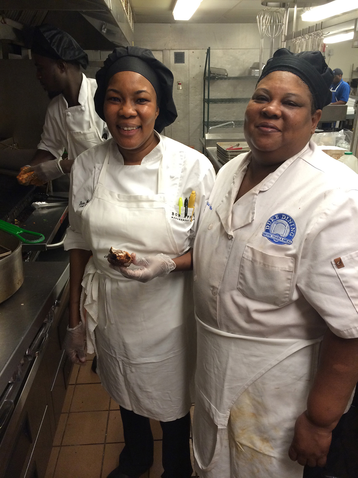 UPenn Sous Chef Fatou Wilson and Duke Dining Lead Production Worker Cynthia Dantzler prepare traditional Senegalese cuisine
