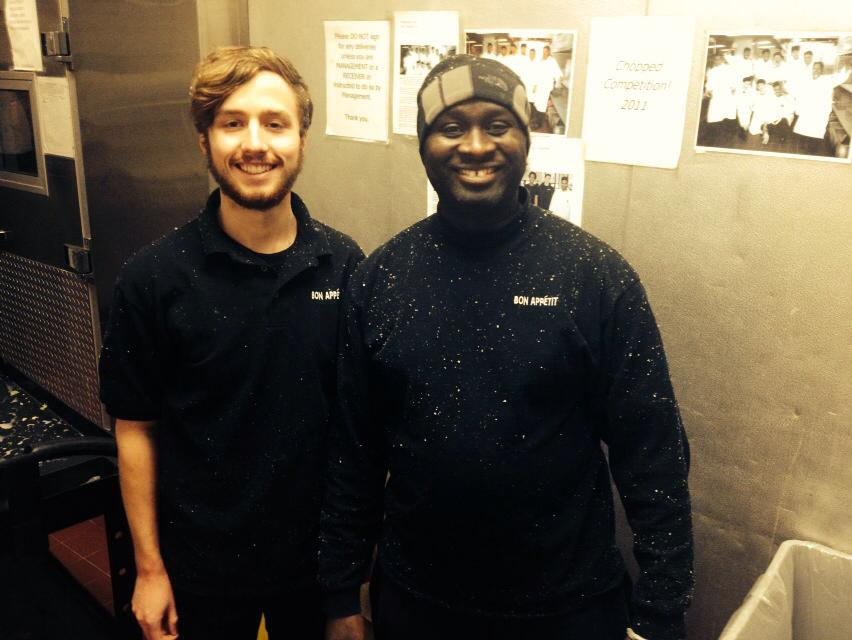 Frank Padula, student worker, and  Mohammed Kanu, floor worker, covered in snow from braving the storm to come in and help.