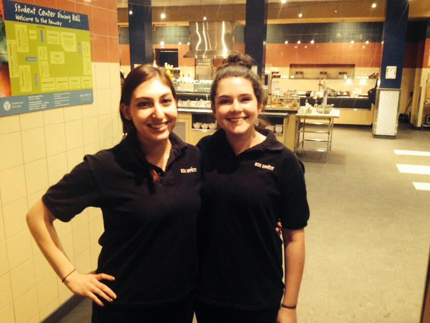 Student workers Shana Solomon and Abigail Murphy lending a hand