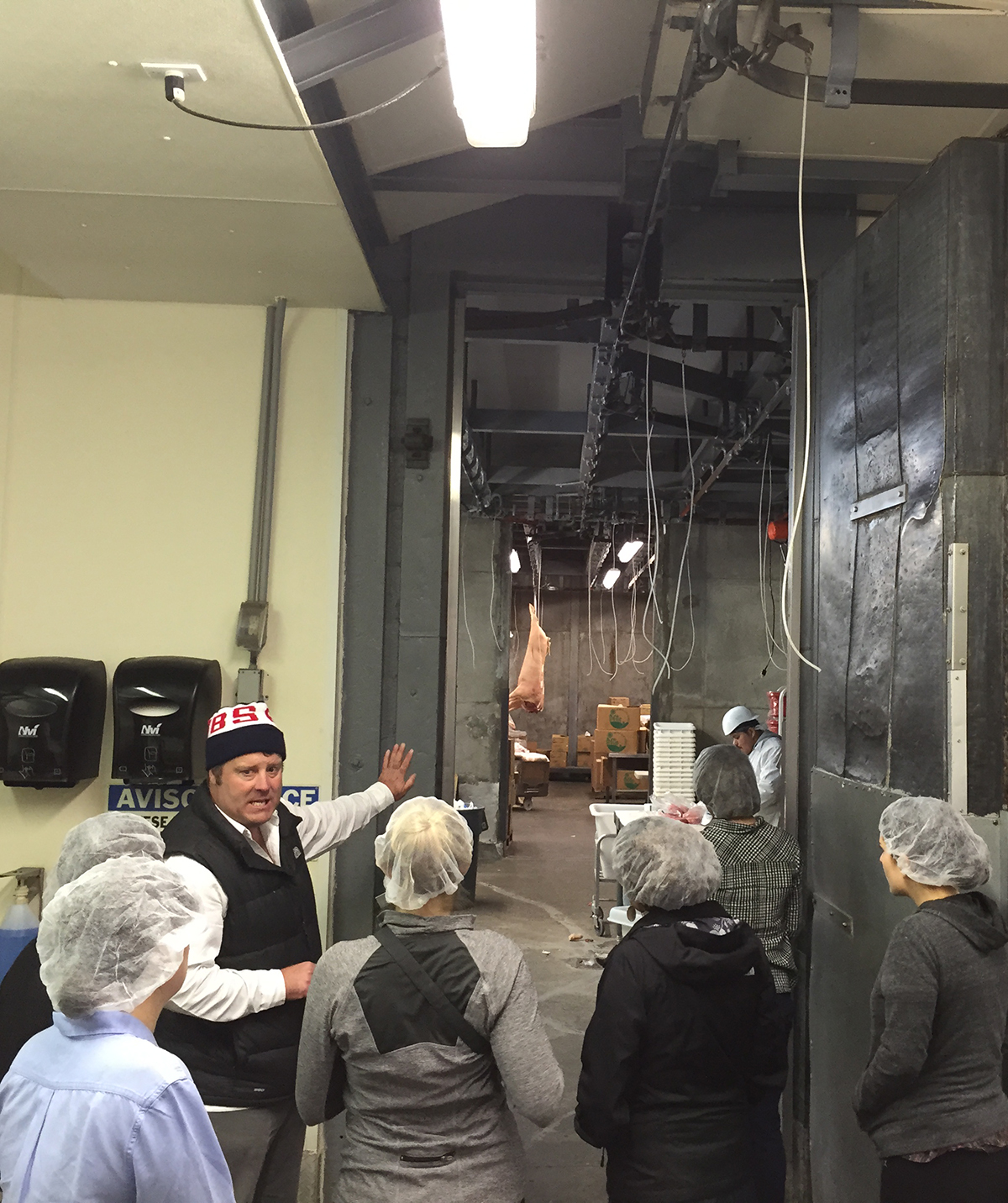 David Evans gives the Bon Appétiters a peek into the cutting room of the Marin Sun Farms slaughterhouse