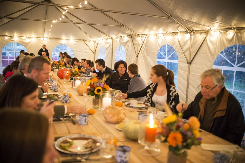 Parents, donors, and friends of St. Timothy's Shcool enjoy the family-style farm to table supper.