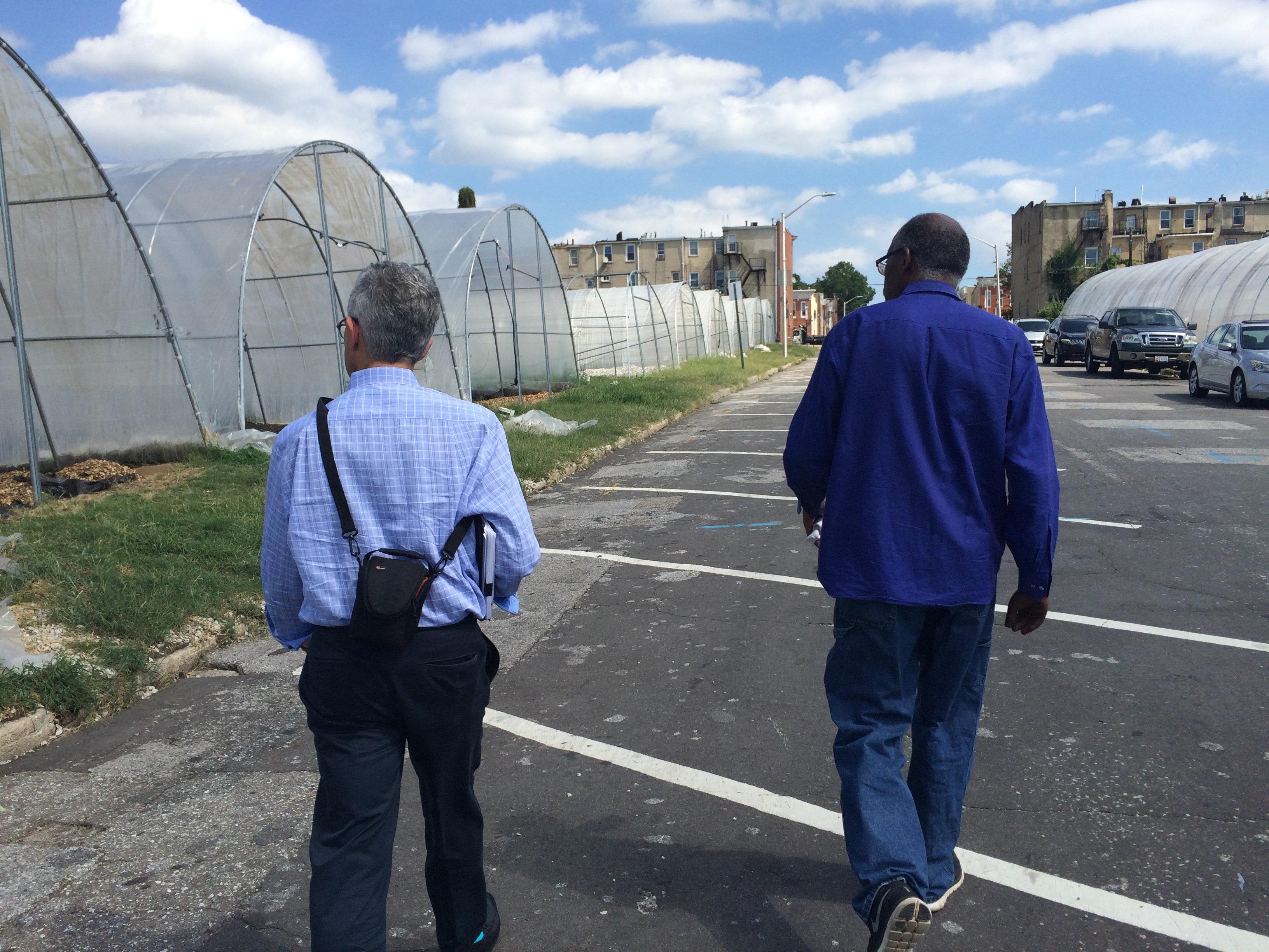 Regional District Manager Norman Zwagil tours Strength to Love II Hoop Houses with the farm's sales manager, Wendall Holmes