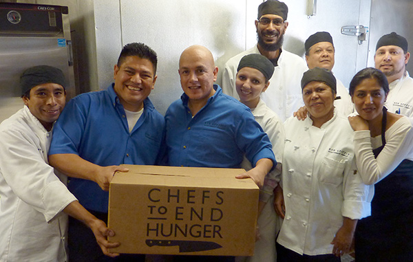 Chefs holding food donation box