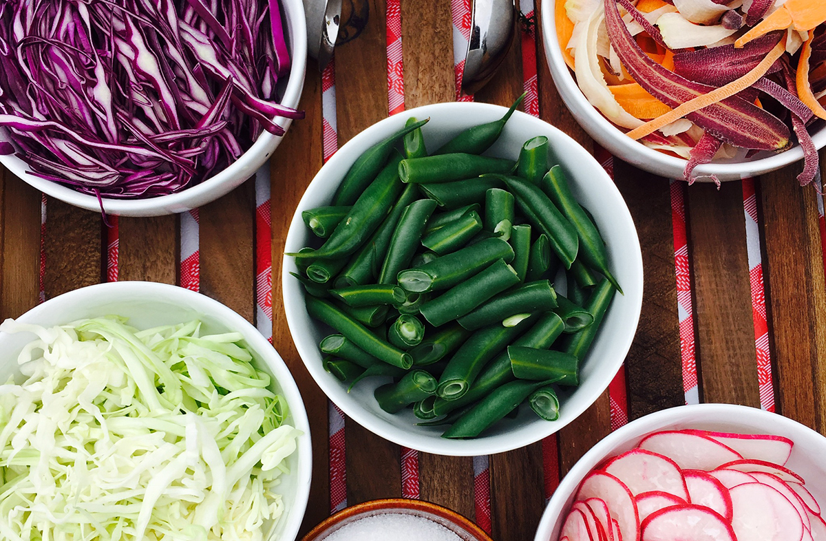 Colorful ingredients harvested from the Presidio's community garden include red and green cabbage, radish, and green beans