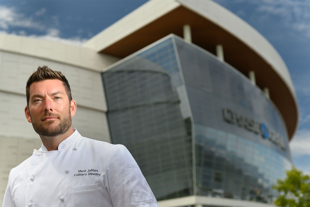 Chef in front of Chase Center