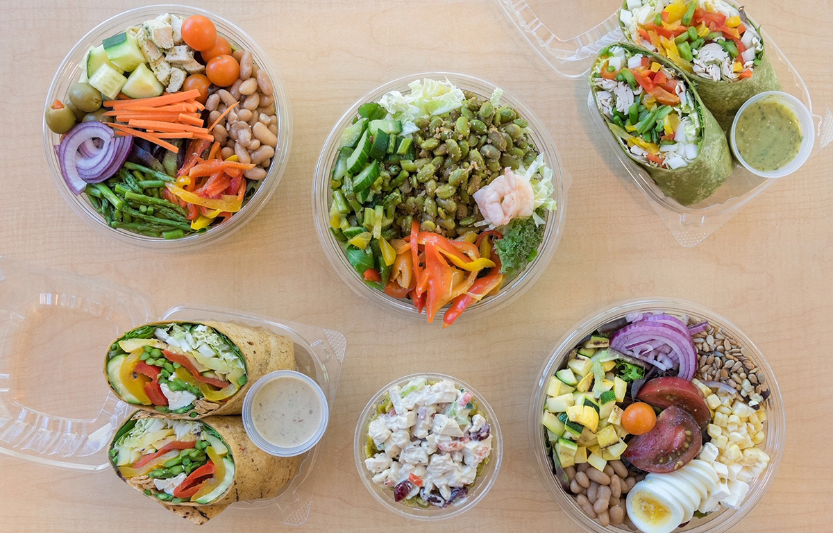 A sample of Chris's new grab-and-go options, featuring plenty of plant-based proteins such as beans and lentils, filling seeds, and judicious amounts of turkey and shrimp