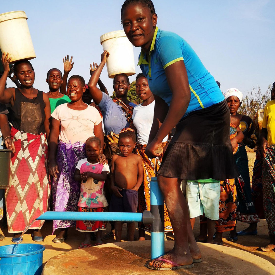 young woman pumping water