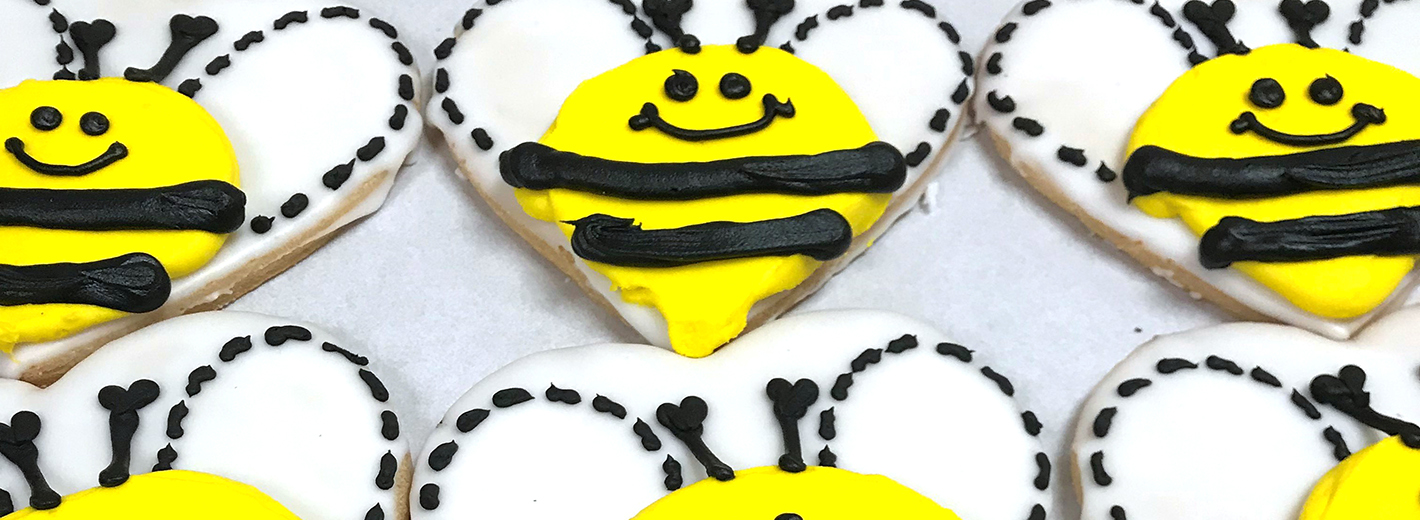 """""""Happy bee"""" cookies to celebrate the hive's successful first year"""