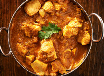 indian-curry-meal-with-balti-dish,-naan,-and-basmati-rice-521875611_header