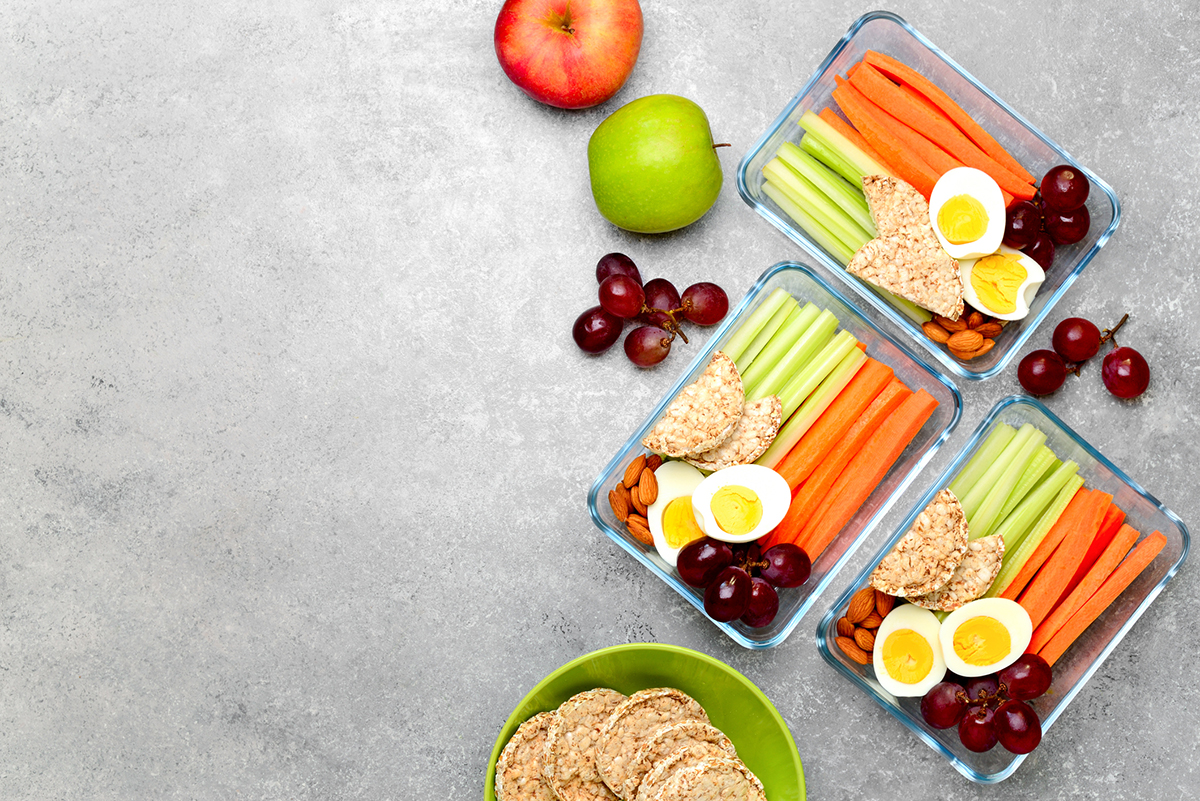 Lunch boxes with healthy snacks, healthy food concept, view from above, blank space for a text